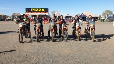 Jason Stewart, on bike 799, at the Finke Desert Race two years ago with friends. He says it is maddening that border closures will stop him racing this year.