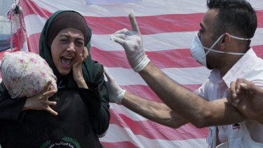 A Palestinian woman reacts in a first aid tent during a protest near Beit Lahiya, Gaza Strip.