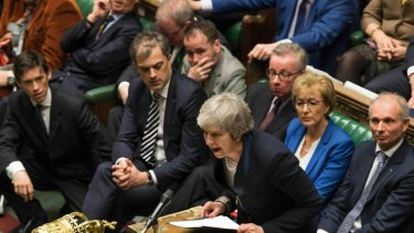 British Prime Minister Theresa May speaks in the House of Commons in London after losing a vote on her Brexit plan on Wednesday, Australian time.