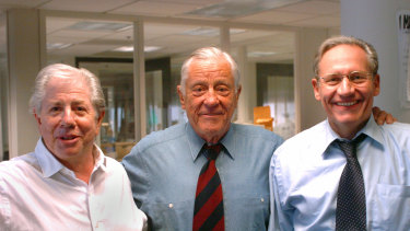 Former Washington Post executive editor Ben Bradlee, centre, poses with Watergate reporters Carl Bernstein, left, and Bob Woodward at the Washington Post in 2005.