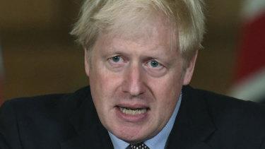 Britain's Prime Minister Boris Johnson announces restrictions.