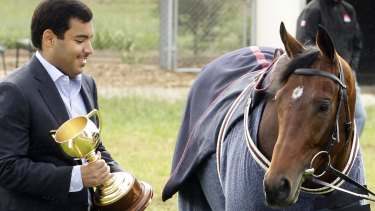 Owner Sheikh Fahad Al-Thani with Dunaden after the 2011 Cup win.