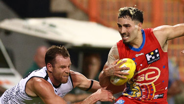 Izak Rankine of the Suns runs with the ball during the round 13 AFL match between the Gold Coast Suns and the Carlton Blues.