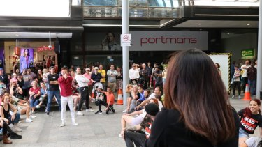 A flash mob proposal in Queen Street Mall saw about 60 Brisbane dancers perform.