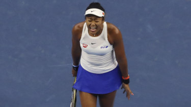 Naomi Osaka fought back after dropping the opening set of the decider in Beijing.