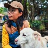 Pet psychic Yoyo Hsu communicates with her dog, Coffee, in Taipei, Taiwan.
