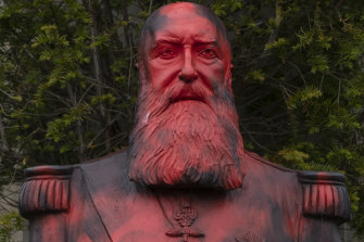A bust of King Leopold II is smeared with red paint and graffiti in Tervuren, Belgium, last month.