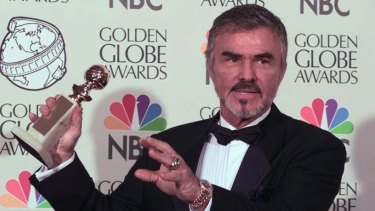 Burt Reynolds holds his award for Best Supporting Actor at the 55th Annual Golden Globe Awards for his role in Boogie Nights.
