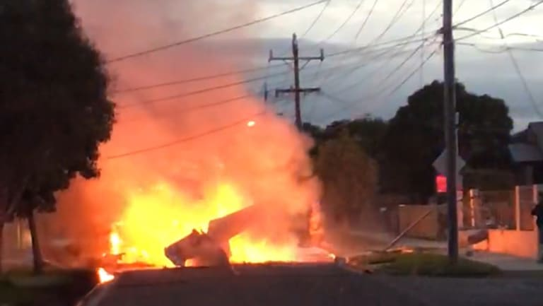 A light plane caught fire after crashing onto a street in Mordialloc