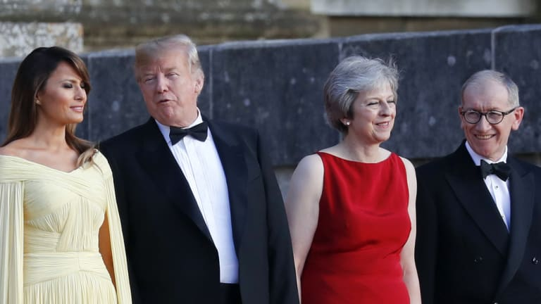 From left, first lady Melania Trump, US President Donald Trump, British Prime Minister Theresa May and her husband Philip May during the arrival ceremony at Blenheim Palace.