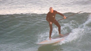 John Macnamara, known as Johnny Mac, has died after he was hit by his paddle board.