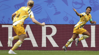 Sam Kerr celebrates scoring Australia's first goal in their opening World Cup match against Italy.