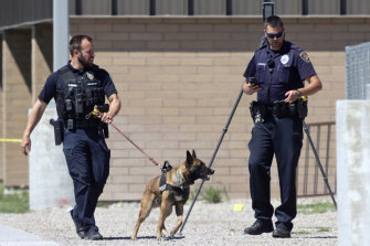 Police officers outside Rigby Middle School in Idaho following a shooting there on Thursday.