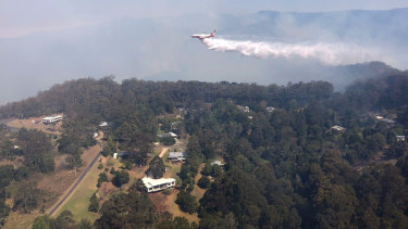 Queensland Fire and Emergency Services' Large Air Tanker drops 15,000L of water over bushfires in Binna Burra.
