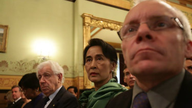 Sean Turnell, right, with Aung San Suu Kyi, centre, and Frank Lowy, left, at the Lowy Institute in 2013.