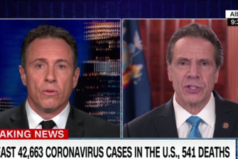 New York Governor Andrew Cuomo, right, is interviewed by his brother, CNN host Chris Cuomo.