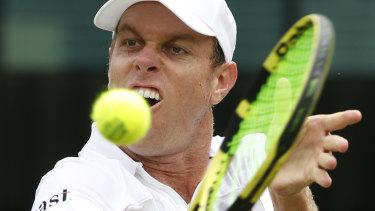 Big gun: Sam Querrey returns to Australia's John Millman on day six at Wimbledon.