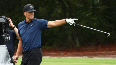 Tom Brady celebrates after his spectacular shot on the seventh hole during The Match: Champions for Charity.