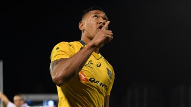 Controversy: Israel Folau celebrates scoring a try for Australia.