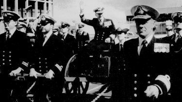 """The Chief of Naval Staff, Vice-Admiral David Leach, retires after 43 years of service. He was ceremoniously """"rowed ashore"""" by his officers in Canberra in 1985."""