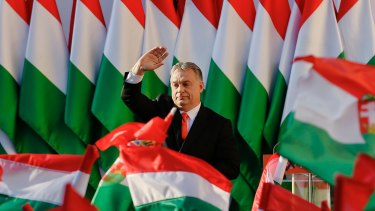 Hungarian Prime Minister Viktor Orban waves during the final electoral rally of his Fidesz party last year.