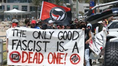 Members of an anti-fascist group in Cronulla at the anniversary of the Cronulla race riots.
