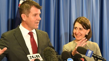 Former NSW premier Mike Baird and then Treasurer Gladys Berejiklian announce the lease of Ausgrid in 2016.