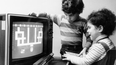 "Dubbed ""two of the luckiest kids"" in the US, Katherine, 3, and her brother, Jesse, 8, try out new games for the Children's Computer Workshop in 1983."