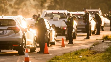 Police enforce the hard border around Melbourne at a roadblock on the Hume Highway in Kalkallo.