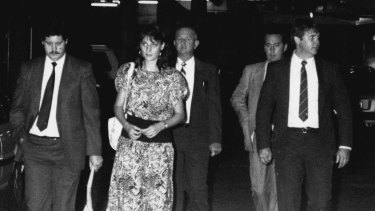Detectives involved in the case leave the Glebe Coroner's Court after John Glover is charged with six murders. Left to right, Detectives Barry Keeling, Murray Byrnes, Kim McGee and Geoff Wright, March 28, 1990.