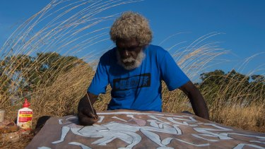 John Mawurndjul, Australian contemporary Indigenous artist working on a bark painting,