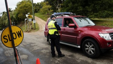 Drivers are stopped by police at the Queensland-NSW border in the Gold Coast hinterland.