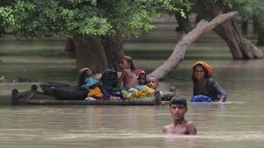 Villagers wade through floodwaters in Rajanpur, Pakistan,  in 2015.