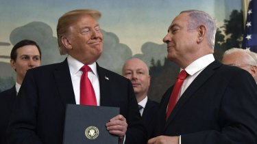 President Donald Trump smiles at Israeli Prime Minister Benjamin Netanyahu, after signing a proclamation formally recognising Israel's sovereignty over the Golan Heights earlier this year.