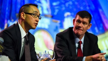 Melco boss Lawrence Ho (left) and James Packer. Mr Ho sold his stake in Crown Resorts in April.