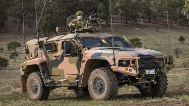 The Coalition government made the unprecedented move of redacting analysis and information from the audit of Australia's purchase of Hawkei light-protected vehicles.