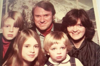 Mike Baird (left) as a child with dad Bruce, mum Judith, who died earlier this year, and siblings Julia and Steve.