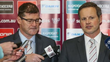 New start: Joe Kelly, seen left with Manly chairman Scott Penn, is also returning to the NRL fold.