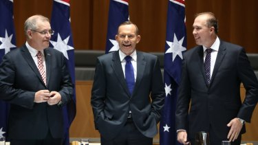 'Lapping at your door': Peter Dutton, then immigration minister (right), jokes in 2015 about rising sea levels in the Pacific with Tony Abbott (centre), the PM at the time.  Scott Morrison, then the social services minister, left.