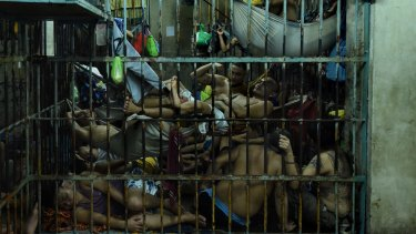 Prisoners inside an over crowded cell in Manila Police Headquarters, Philippines as a result of Duterte's drug crackdown. So they can sleep, prisoners here rotate positions.