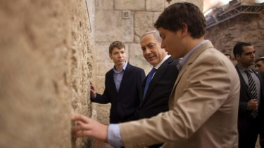 Israeli Prime Minister Benjamin Netanyahu, centre, prays with his sons Yair, background, and Avner, right, at the Western Wall in Jerusalem's Old City in 2013.