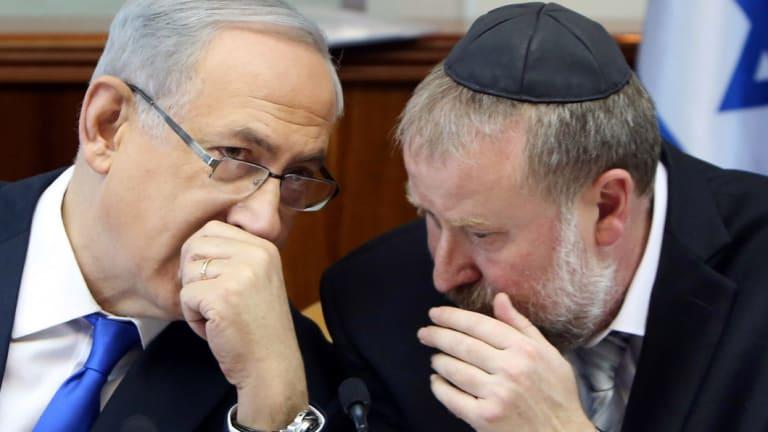 Netanyahu, left, with Avichai Mandelblit back in December 2015.