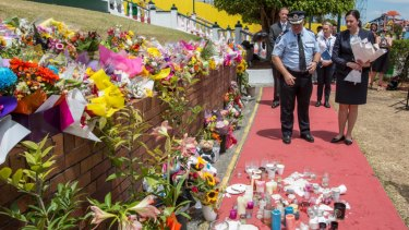 Queensland Premier Annastacia Palaszczuk and Assistant Commissioner Brian Codd pay their respects after Dreamworld disaster.