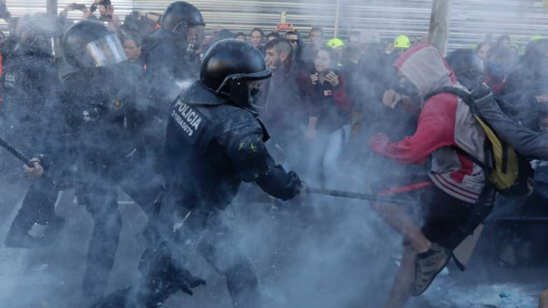Police charge against protesters during a demonstration by  the Committees for the pro-independence Defence of the Republic in Barcelona, Spain in November.