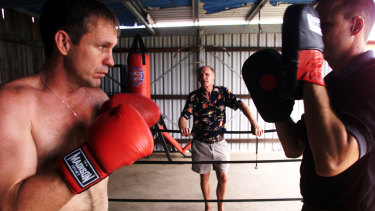 Fighting family: Ricky Thornberry (left) trains with his brother Noel as Trevor watches on in Gatton in 2002.