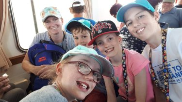 Petrina Brown (far left) was with her husband and four children aboard the cruise ship when the volcano erupted.