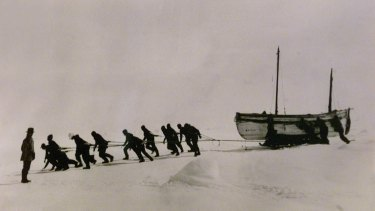 Copy of a photo taken by Frank Hurley in 1914-15 of the James Caird being towed across ice in Antarctica by Ernest Shackleton and the crew of the Endurance.