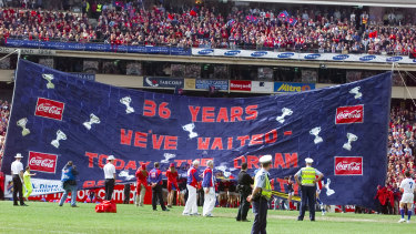 The Demons banner in the 2000 grand final.