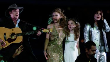 Vanessa Amorosi (right) on stage at the Sydney Olympics alongside Slim Dusty, Kylie Minogue and Nikki Webster