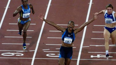 Marion Jones wins the 100m at the Sydney Olympics.
